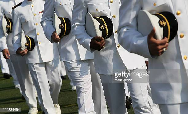S Naval Academy graduates walk to their seats during graduation ceremonies at the US Naval Academy May 27 2011 in Annapolis Maryland US Secretary of...