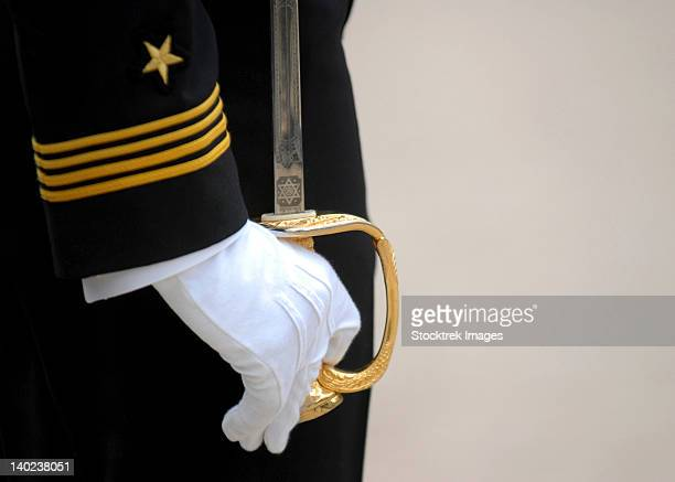 A U.S. Naval Academy midshipman stands at attention.