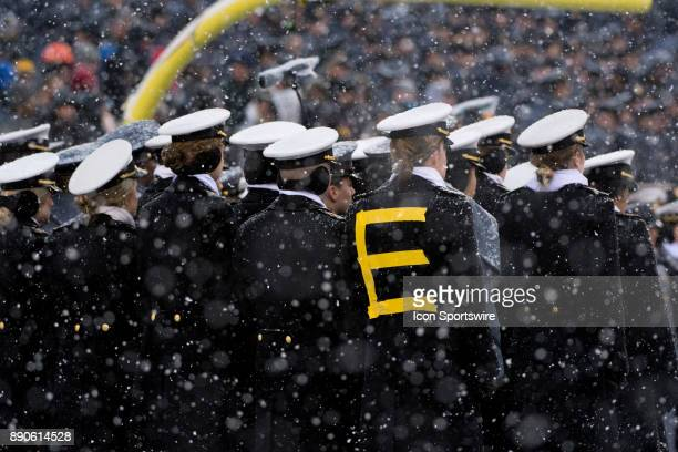 Naval Academy Midshipman wears an 'E' of 'REVENGE' as a part of the National Anthem singers before the game between The Army Black Knights and Navy...