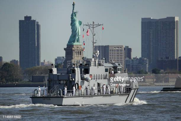 Naval Academy Yard Patrol Boat sails past the Statue of Liberty during the Fleet Week Parade of Ships in New York Harbor, May 22, 2019 in New York...