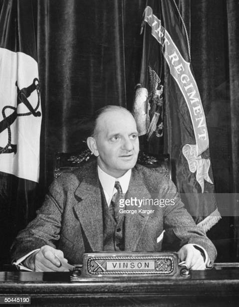 Naval Affairs Committee Chairman Carl Vinson posing for a picture during a meeting