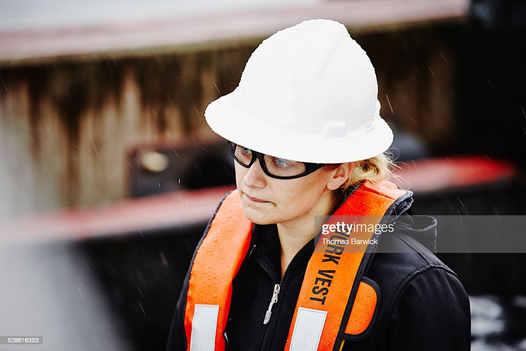Naval architect wearing hardhat and safety glasses : Stock Photo
