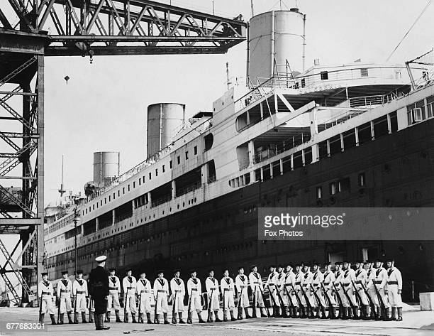 Naval cadets undergo rifle drill on the quayside beside the former White Star Ocean going passenger liner the RMS Majestic which has been converted...