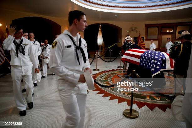 Naval cadets walk past the casket during a memorial service for US Senator John McCain at the Arizona Capitol on August 29 in Phoenix.