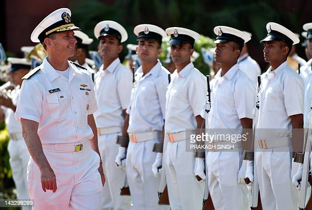US Naval Chief of Operations Admiral Jonathan Greenert inspects a guard of honour prior to a meeting with Indian Navy Chief Admiral Nirmal Verma in...