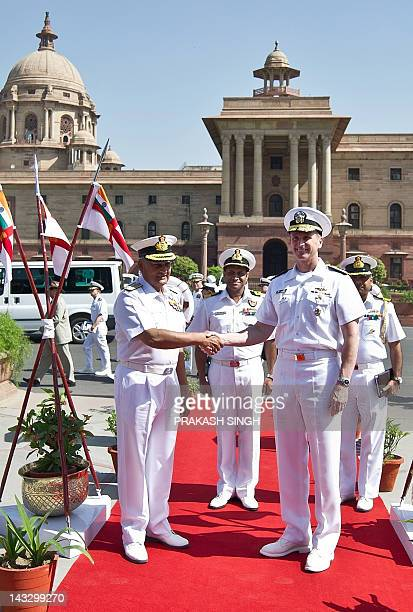 US Naval Chief of Operations Admiral Jonathan Greenert shakes hands with Indian Navy chief Admiral Nirmal Verma prior to a meeting in New Delhi on...
