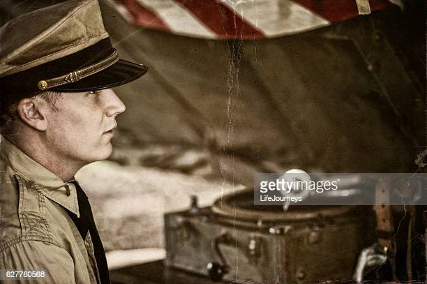 naval officer and old phonograph in a tent on site - picture of phonograph stock photos and pictures