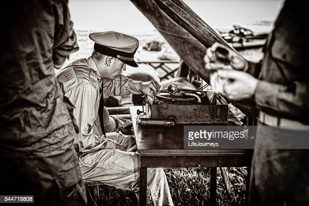 naval officer enjoying the music on his vintage phonograph - segunda guerra mundial fotografías e imágenes de stock