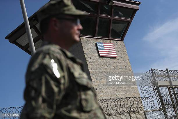 A US Naval officer stands at the entrance of the US prison at Guantanamo Bay also known as Gitmo on October 22 2016 at the US Naval Station at...
