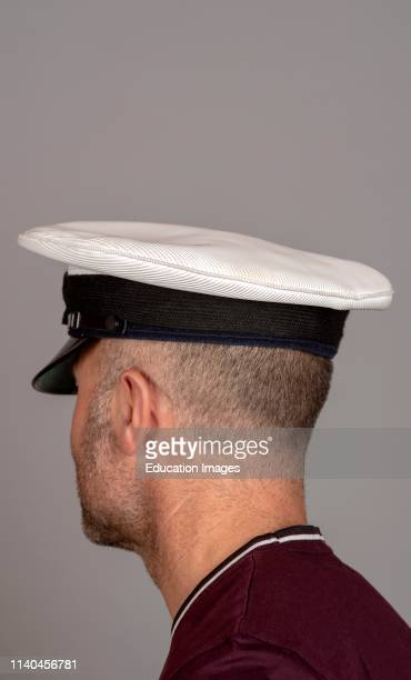 Naval officer with short hair and military uniform cap
