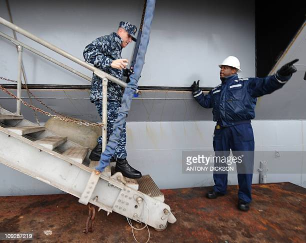A naval personnel attached to the USS Blue Ridge disembarks from the ship in Hong Kong on February 19 2011 The USS Blue Ridge flagship for the...