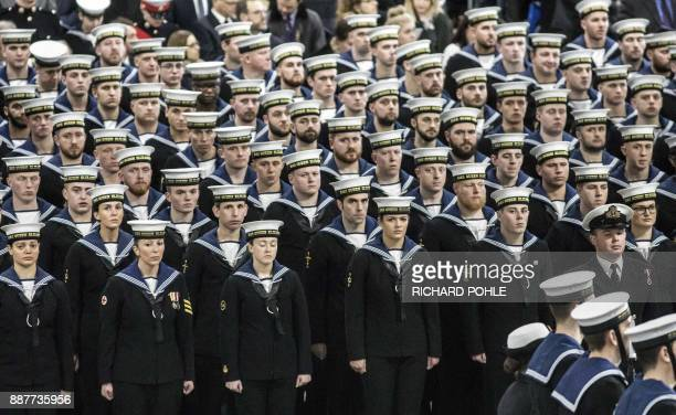 Naval ratings stand to attention during the Commissioning Ceremony for the Royal Navy aircraft carrier HMS Queen Elizabeth at HM Naval Base in...