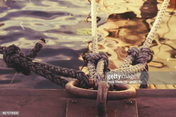 naval ropes on a pier. vintage nautical knots. - nautical vessel ストックフォトと画像