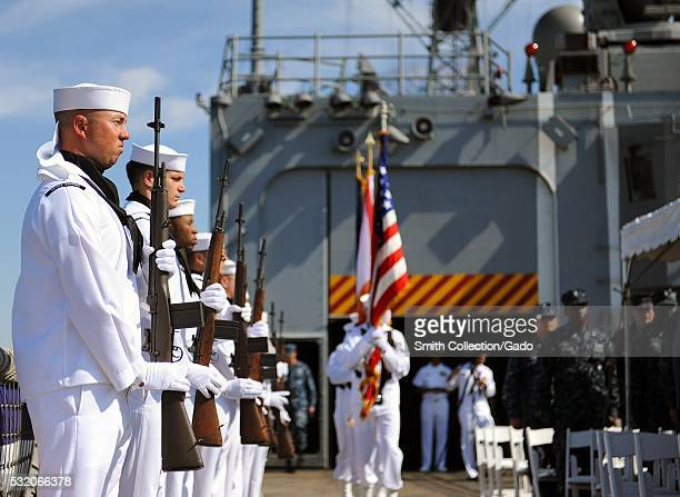 Naval Station Mayport's color guard parade the colors during a wreath laying ceremony at Naval Station Mayport commemorating the 70th Anniversary of...