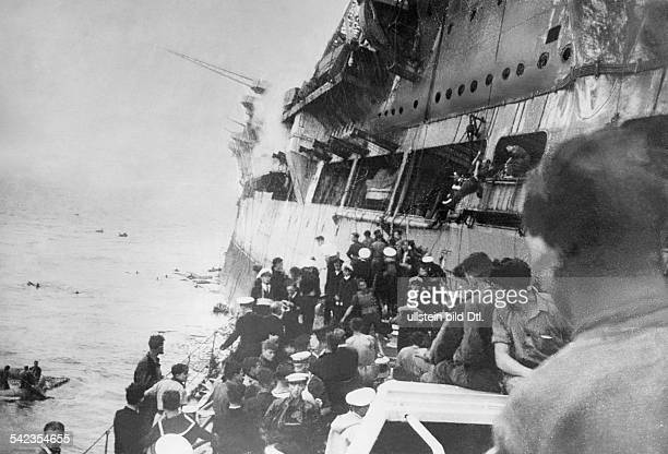 2WW Naval warfare mediterranean British aircraft carrier 'HMS Ark Royal' hit by a torpedo of german submarine U81 on 131141 sinking on 1411 east of...