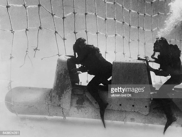 2 WW naval warfare mediterranen seaItalian frogmen riding on a submarine torpedo breaking through the british netbarrier ahead of Gibraltar 1941/42