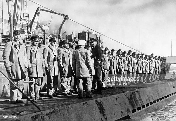 WW II naval warfare UBoat war The flotilla commander welcomes a uboat crew which has returned to its naval base in france about BCZ