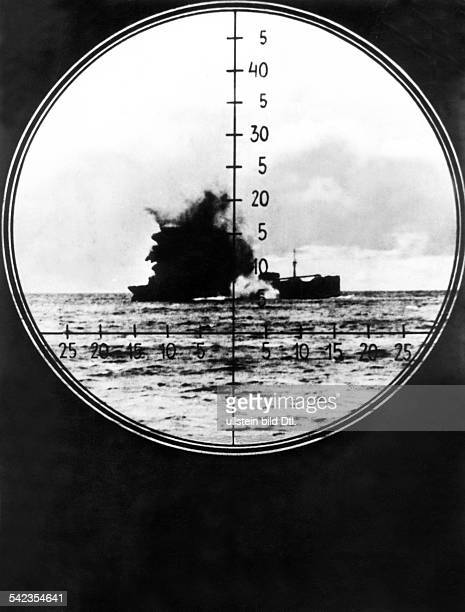 WW II naval warfare UBoat war View through the periscope a sinking enemy vessel hit by a Uboat torpedo1942
