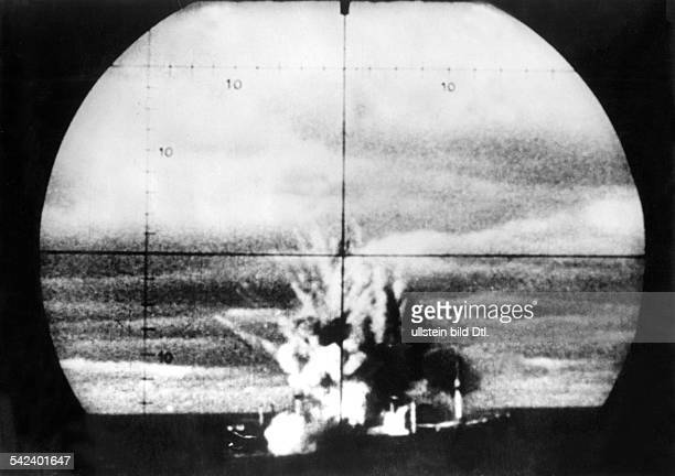 WW II naval warfare UBoat war View through the periscope of a uboat at a torpedo hit US cargo vessel off the US coast 1942Erika 7/8 1942