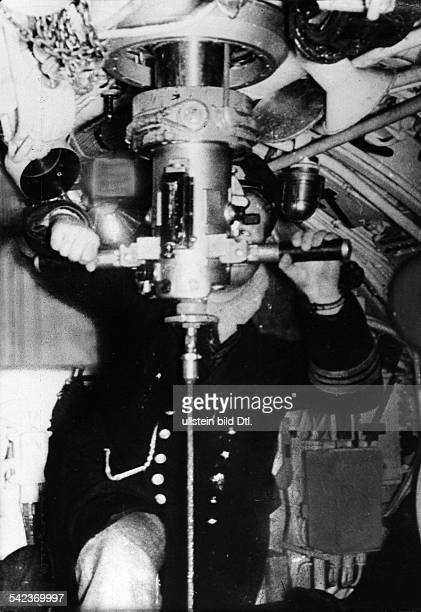 WW II naval warfare UBoat war WUBoat The commander of a German submarine eyes his opponent through the periscope 1942