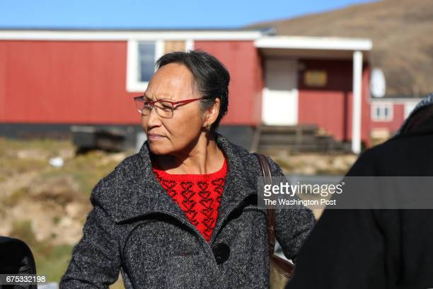 Navarana Sorensen shops at an annual outdoor market in Qaanaaq Greenland on August 26 2016 by Whitney Shefte/The Washington Post via Getty Images...