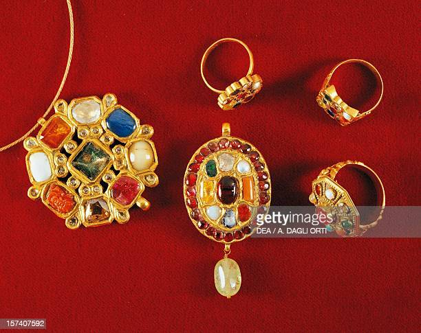 Navaratna pendants and rings with nine stones set in gold symbolising the planets of the solar system India 19th century