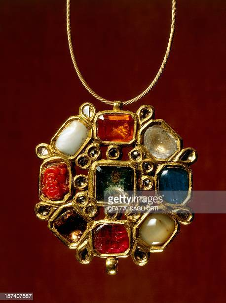 Navaratna pendants with nine stones set in gold symbolising the planets of the solar system Reverse decorative floral motifs India late 19th century