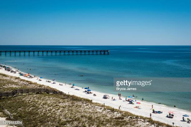 navarre beach vacationers - brycia james stock pictures, royalty-free photos & images