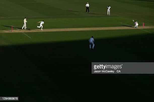 Navdeep Saini of India bowls to Steve Smith of Australia during day one of the 3rd Test match in the series between Australia and India at Sydney...