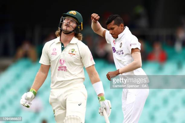 Navdeep Saini of India celebrates dismissing Will Pucovski of Australia during day one of the Third Test match in the series between Australia and...