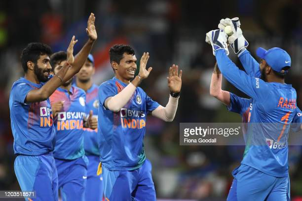 Navdeep Saini takes the wicket of Ross Taylor of the Black Caps during game five of the Twenty20 series between New Zealand and India at Bay Oval on...