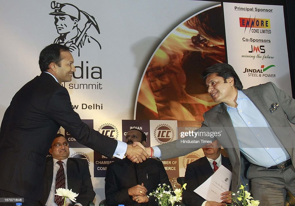 Naveen Jindal Chairman and Managing Director Jindal Steel and Power Ltd. and member of parliament handshake with Sandeep Jajodia Chairman Monnet Group attending the inaugural session of Indian Coal Industry outlook till 2030 on November 28, 2012 in New Delhi, India.