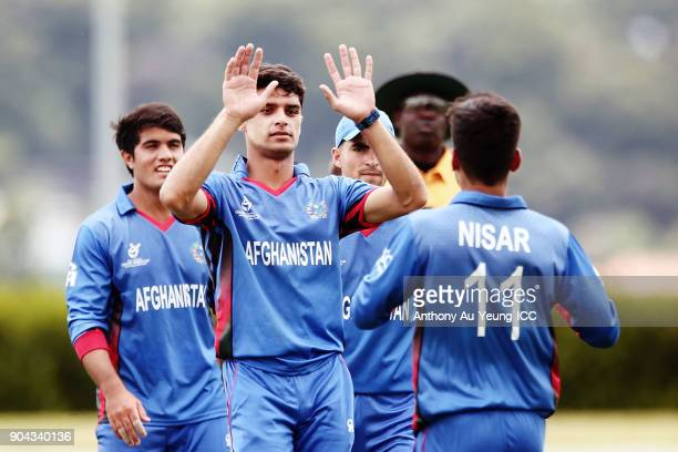 NaveenulHaq of Afghanistan celebrates the wicket of Shaheen Afridi of Pakistan during the ICC U19 Cricket World Cup match between Pakistan and...