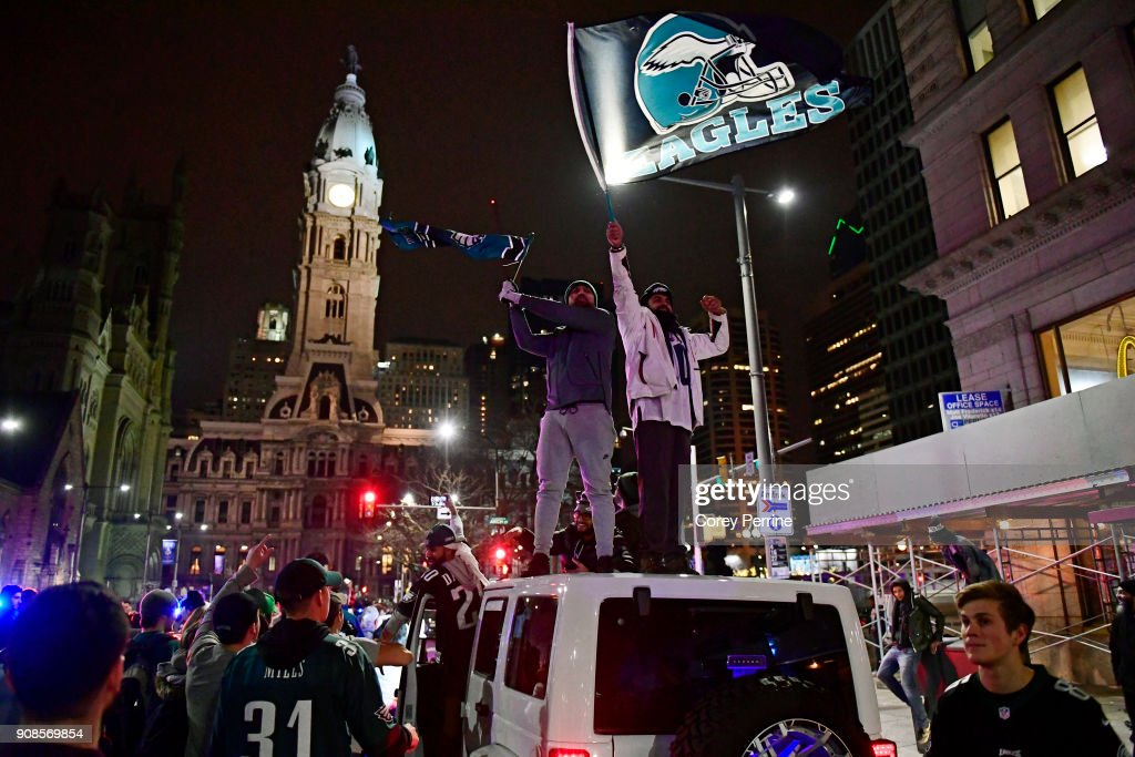 Naveet Singh (L) and Gurvinder Singh, both brothers from Middlesex County, New Jersey, wave Eagles flags while stopped in traffic on North Broad Street with droves of Philadelphia Eagles fans downtown near City Hall on January 21, 2018 in Philadelphia, Pennsylvania. Supporters celebrated in the streets the 38-7 win over the Minnesota Vikings in the NFC Championship game.