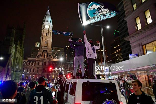 Naveet Singh and Gurvinder Singh both brothers from Middlesex County New Jersey wave Eagles flags while stopped in traffic on North Broad Street with...
