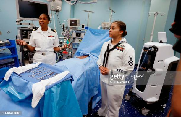 Navel officers explain one of the procedure rooms inside the US Naval hospital ship Comfort docked at the Port of Miami in Miami Florida on June 18...