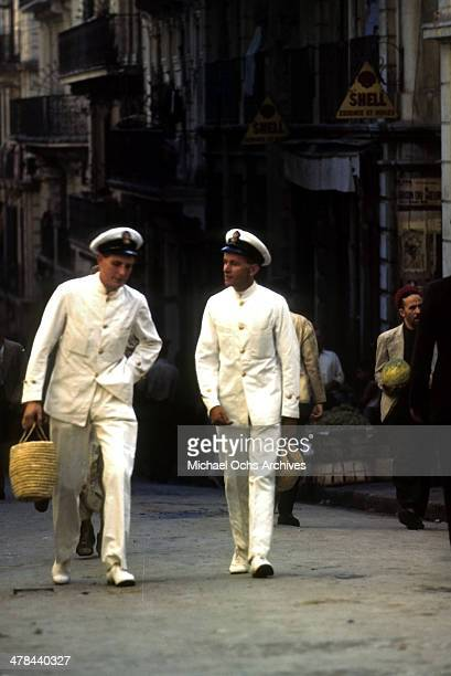Navel Officers walk in the Casbah of Algiers Algeria Off limits to US servicemen and patrolled by Military Police French and Algerian Police
