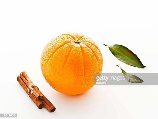 navel orange with tied cinnamon sticks - navel orange stock photos and pictures