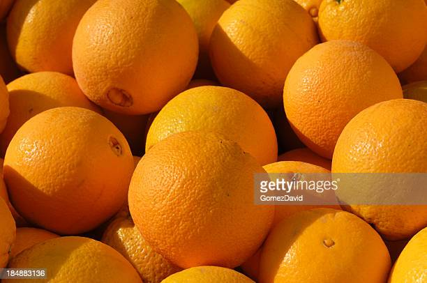 navel oranges in shipping crate - navel orange stock photos and pictures