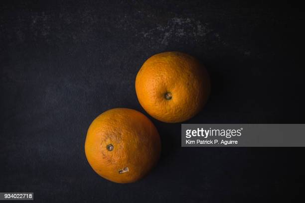 navel oranges on black - navel orange stock photos and pictures