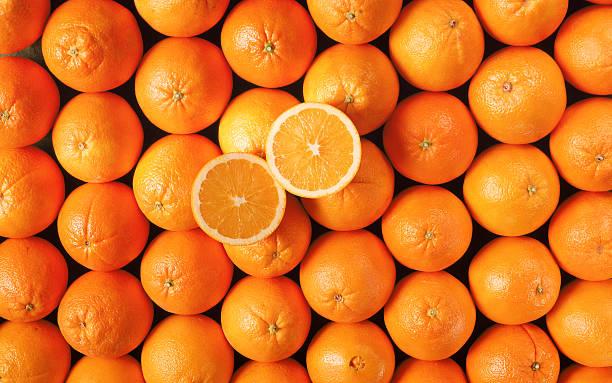 navel oranges with halves - navel orange fotografías e imágenes de stock