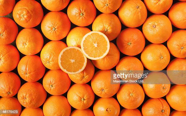 navel oranges with halves - navel orange stock photos and pictures