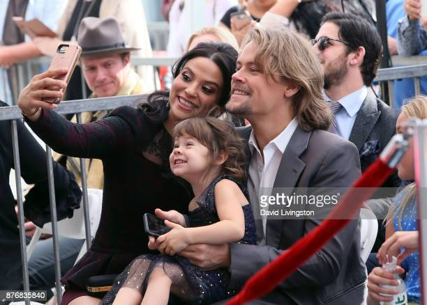 Navi Rawat and Brawley Nolte pose for a selfie at Nick Nolte being honored with a Star on the Hollywood Walk of Fame on November 20 2017 in Hollywood...