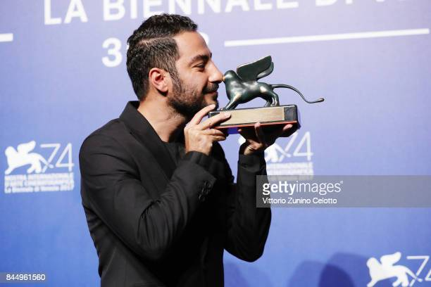 Navid Mohammadzadeh poses with the 'Orizzonti' Award for Best Actor for 'Bedoune Tarikh Bedoune Emza' at the Award Winners photocall during the 74th...