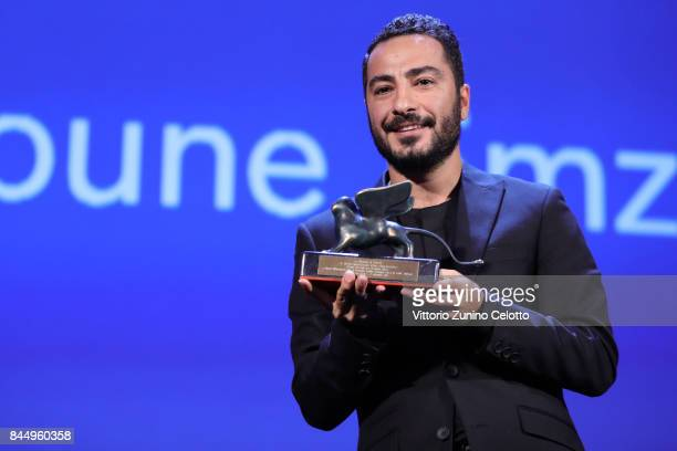 Navid Mohammadzadeh receives 'Orizzonti' Award for Best Actor for 'Bedoune Tarikh Bedoune Emza' during the Award Ceremony of the 74th Venice Film...