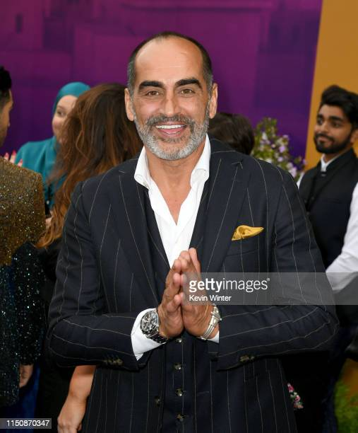 Navid Negahban arrives at the premiere of Disney's Aladdin at the El Capitan Theater on May 21 2019 in Los Angeles California