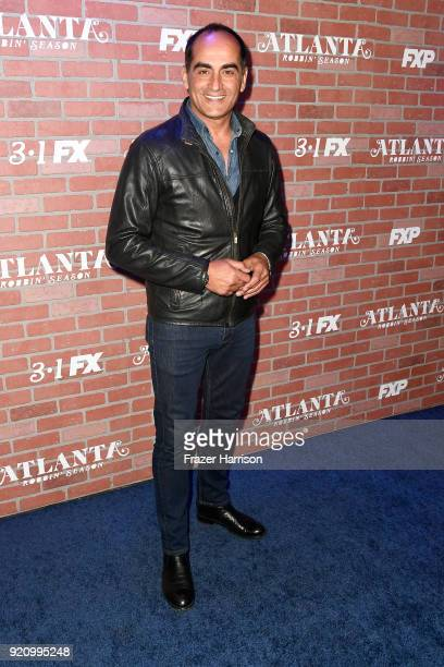 Navid Negahban attends the premiere for FX's Atlanta Robbin' Season at The Theatre at Ace Hotel on February 19 2018 in Los Angeles California
