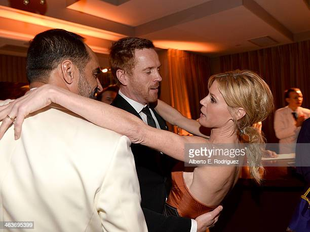 Navid Negahban Damian Lewis and Julie Bowen attend the Weinstein Company Netflix's 2014 SAG after party in partnership with Laura Mercier at Sunset...