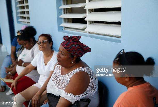 Navidad Rodriguez sits on a bench at a shelter after being displaced by Hurricane Irma on St John in the US Virgin Islands on Sept 12 2017 The island...