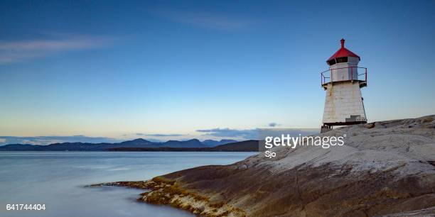 navigation beacon on tingholmen in norway during sunset - coastline stock pictures, royalty-free photos & images